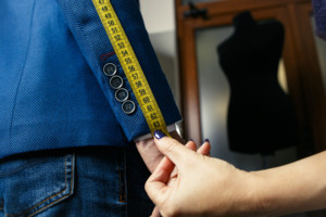 Tailor taking measurements